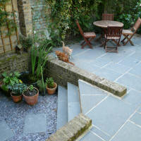 Garden patio in Peckham with new and reused flag stones