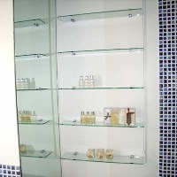 Modern bathroom glass shelves and mosaic tiling fitted by Jobsmiths
