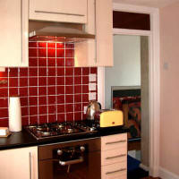 New fitted Kitchen with cooker and hood, plus new tiles